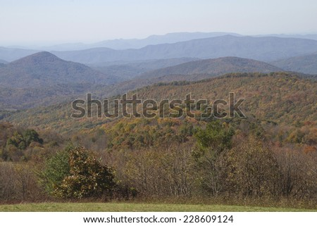 Overlooking the scenic Appalachian Mountains of Western North Carolina by Max Patch with forests drenched in autumn color - stock photo