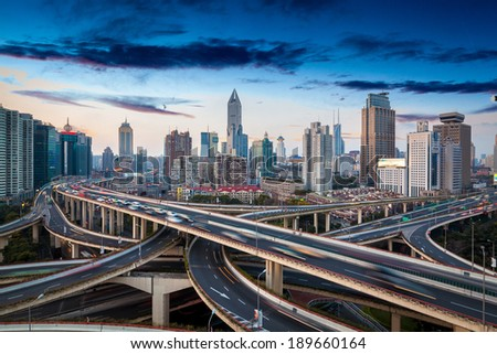 overlooking the vehicle motion blur on shanghai elevated road junction and interchange overpass - stock photo