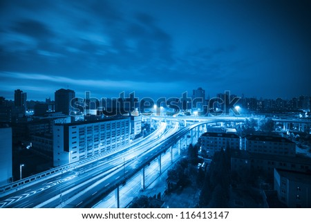 overlooking the viaduct in shanghai at dawn with blue tone