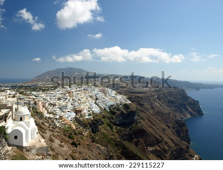 Overlooking the village of Fira with a church in foreground.