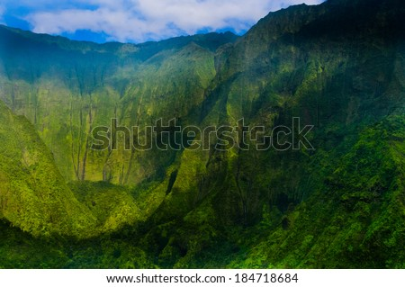 Overlooking Waimea Canyon State Park on the island of Kauai, Hawaii, USA, nicknamed the Grand Canyon of the Pacific. - stock photo
