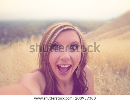 overly excited attractive woman taking selfie with instagram overlay - stock photo