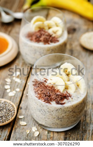 overnight banana oats quinoa Chia seed pudding decorated with banana and chocolate. the toning. selective focus - stock photo