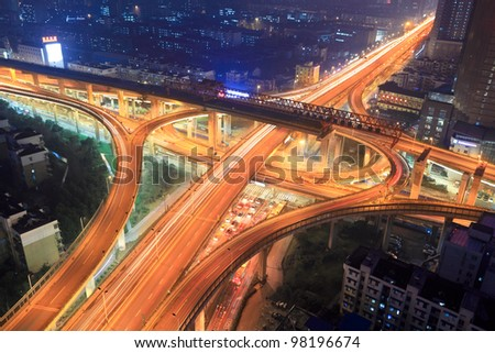 overpass in modern city at night - stock photo