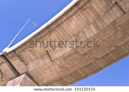 Overpass over blue sky - stock photo