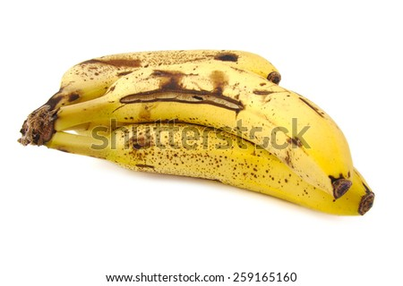 Overripe and rotten bananas on a white background - stock photo