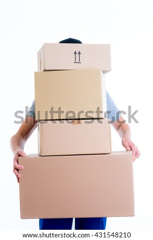 overstrained postman with parcels in front of white background - stock photo