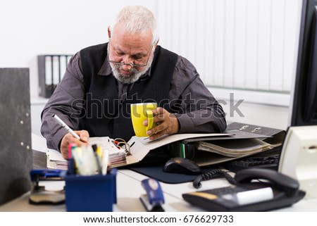 Overstressed businessman with burnout in his office
