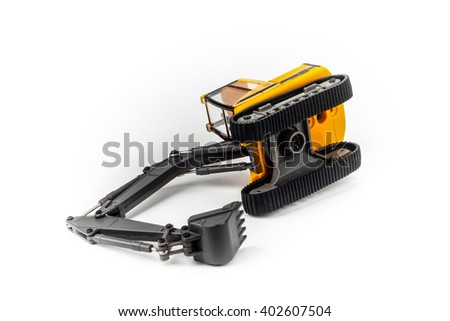 Overturned miniature excavator isolated on white background - stock photo