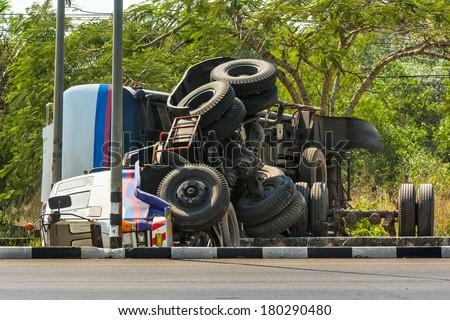 overturned truck accident on highway road - stock photo