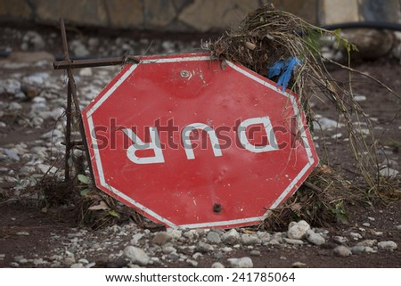 Overturned Turkish Stop Sign - Flood Disaster in Olympos, Turkey, Asia - stock photo