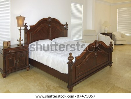 Overview of a beautiful classic bedroom suite in a private residence with a travertine floor - stock photo