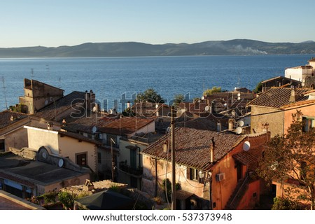 Overview of Anguillara ancient town over Bracciano lake, Italy