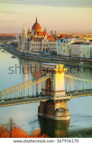 Overview of Budapest with the Parliament building at sunrise - stock photo
