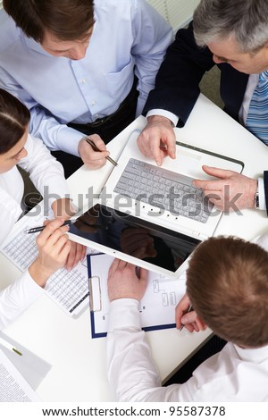 Overview of business people discussing new project - stock photo
