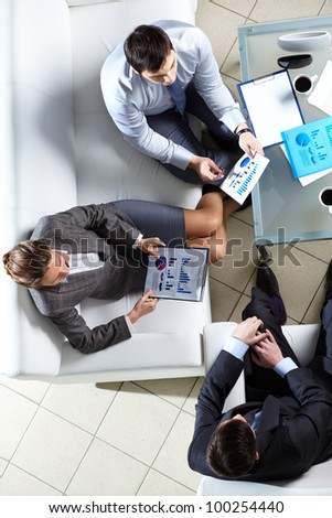 Overview of business team discussing some graphs and diagrams - stock photo