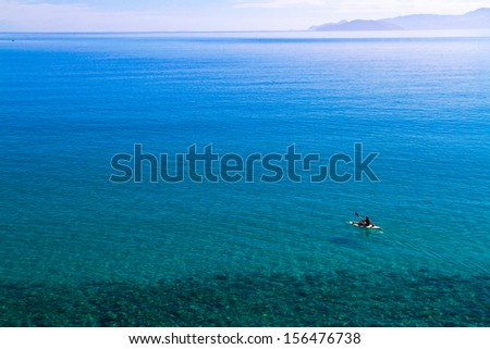Overview of crystal-clear turquoise waters peaceful bay northeast of Crete. - stock photo