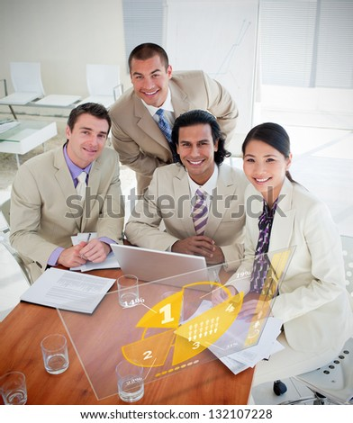 Overview of happy colleagues using yellow pie chart interface in a meeting - stock photo