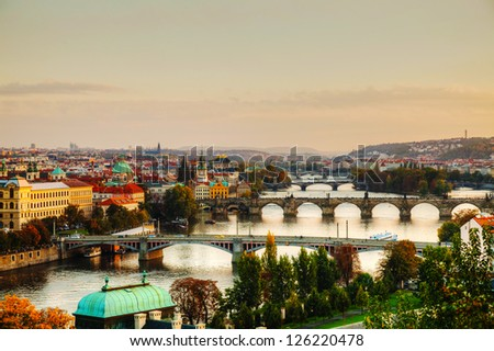 Overview of old Prague with Charles bridge at sunset - stock photo