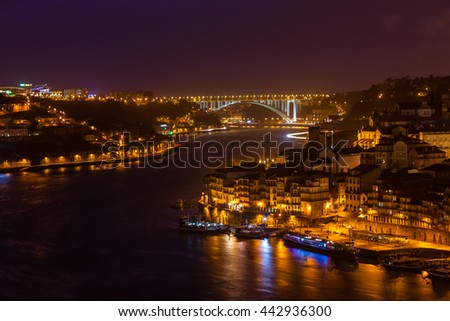 Overview of Old Town of Porto, Portugal at night. Horizontal shot - stock photo