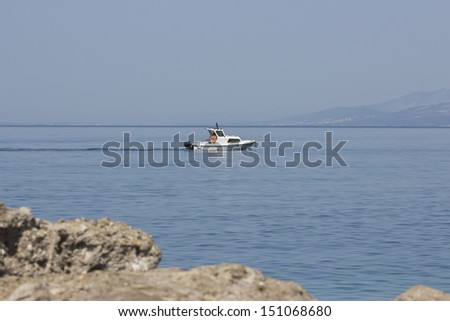 Overview of seascape in Croatia, white boat