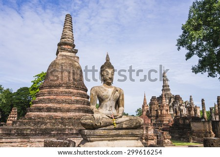 Overview of Stupa and Buddha Statue in Wat Mahathat Temple, Sukhothai Historical Park, Thailand  - stock photo