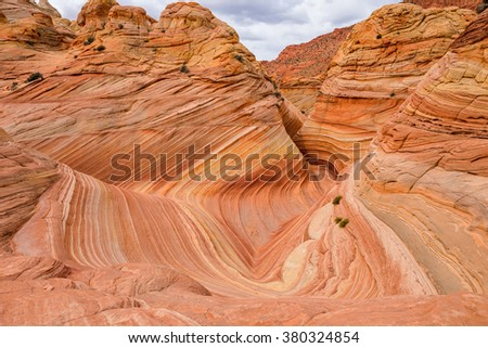 Overview of the center of The Wave - a dramatic and colorful erosional sandstone rock formation located in North Coyote Buttes area of Paria Canyon-Vermilion Cliffs Wilderness at Arizona-Utah border. - stock photo