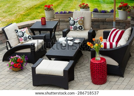 Overview Of Upscale Patio Set, Dark Wicker Luxury Furniture With  Comfortable Cushions On Outdoor Stone