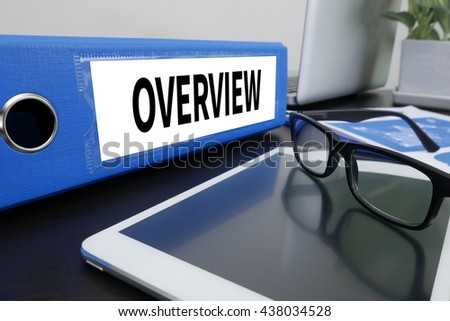 OVERVIEW Office folder on Desktop on table with Office Supplies. ipad - stock photo