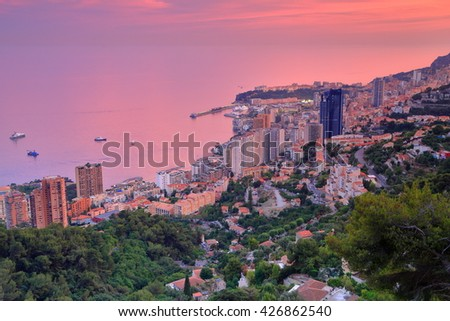 Overview to Monte Carlo and surrounding sea at dusk, Monaco, French Riviera - stock photo