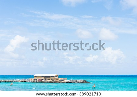 Overwater villas in blue tropical lagoon, Bora Bora, French Polynesia, South Pacific, Hawaii - stock photo