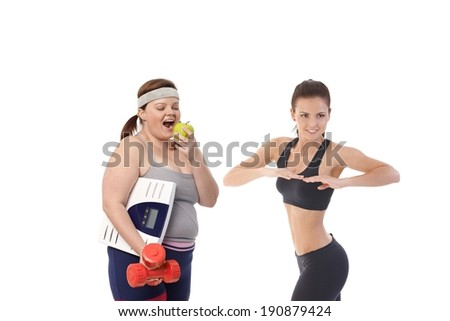 Overweight and slim women having diet together to be fit and healthy. - stock photo