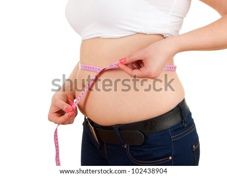 overweight, fat  woman measuring her stomach, white background - stock photo