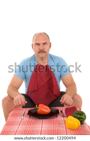 Overweight man looking very unhappy with a plate with a pepper on it - stock photo