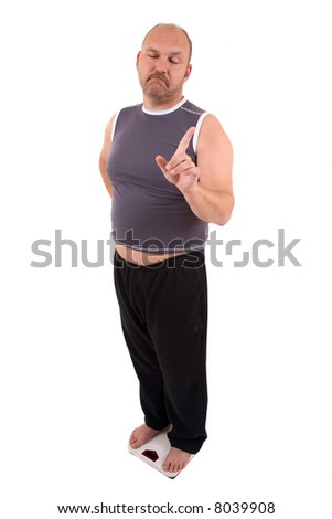 Overweight man standing on the scale
