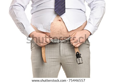 Overweight man trying to fasten too small clothes isolated on white background - stock photo