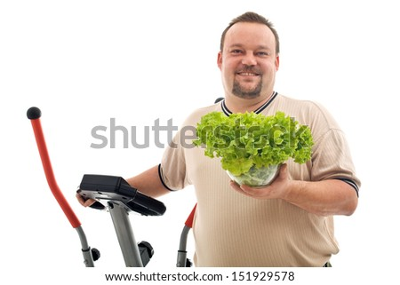 Overweight man with healthy choices - exercise and fresh food, isolated - stock photo