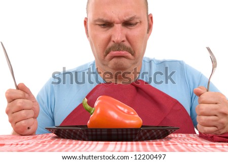 Overweight man with healthy vegetable on plate looking unhappy (focus on pepper)