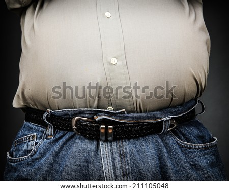 Overweight stomach (shallow focus) - stock photo