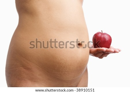 Overweight woman body holding apple, a concept to started a diet - stock photo