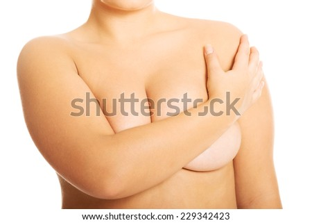 Overweight woman covering her breast.