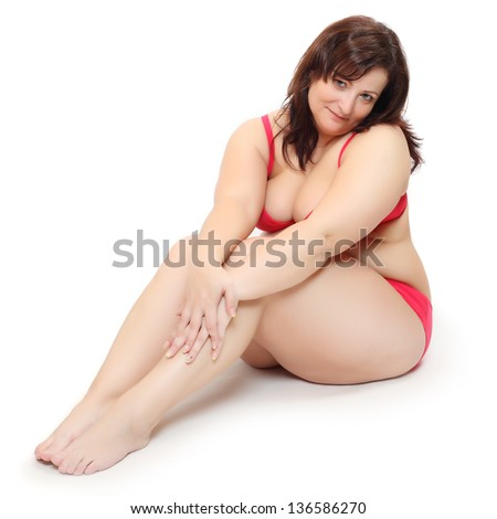 Overweight woman dressed in bikini. - stock photo