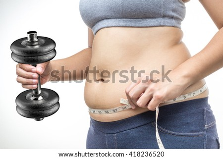 overweight woman hand holding tape measure and dumbbell - stock photo