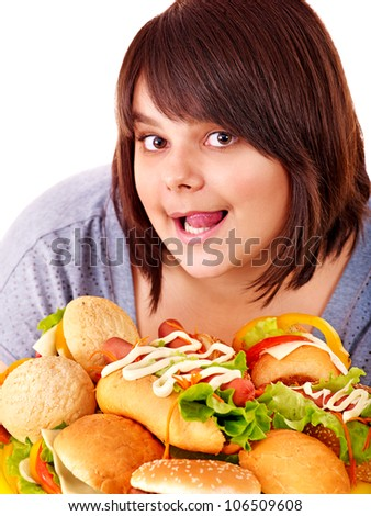 Overweight woman holding hamburger.