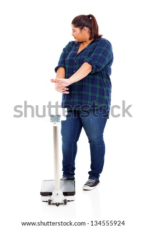 overweight woman refuse to go on scale for weighting - stock photo