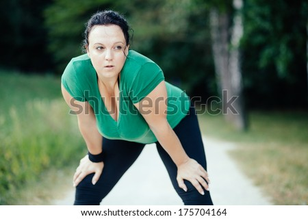 Overweight woman resting after a long run