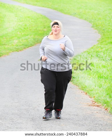 Overweight woman running. Weight loss concept. - stock photo