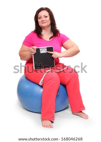 Overweight woman with measure tape and weighing machine.  - stock photo