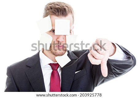 Overwhelmed businessman showing thumb down - stock photo