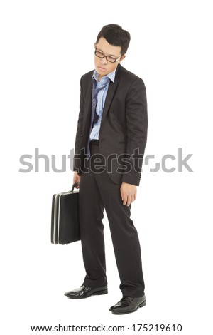 overwork and exhausted businessman holding briefcase - stock photo